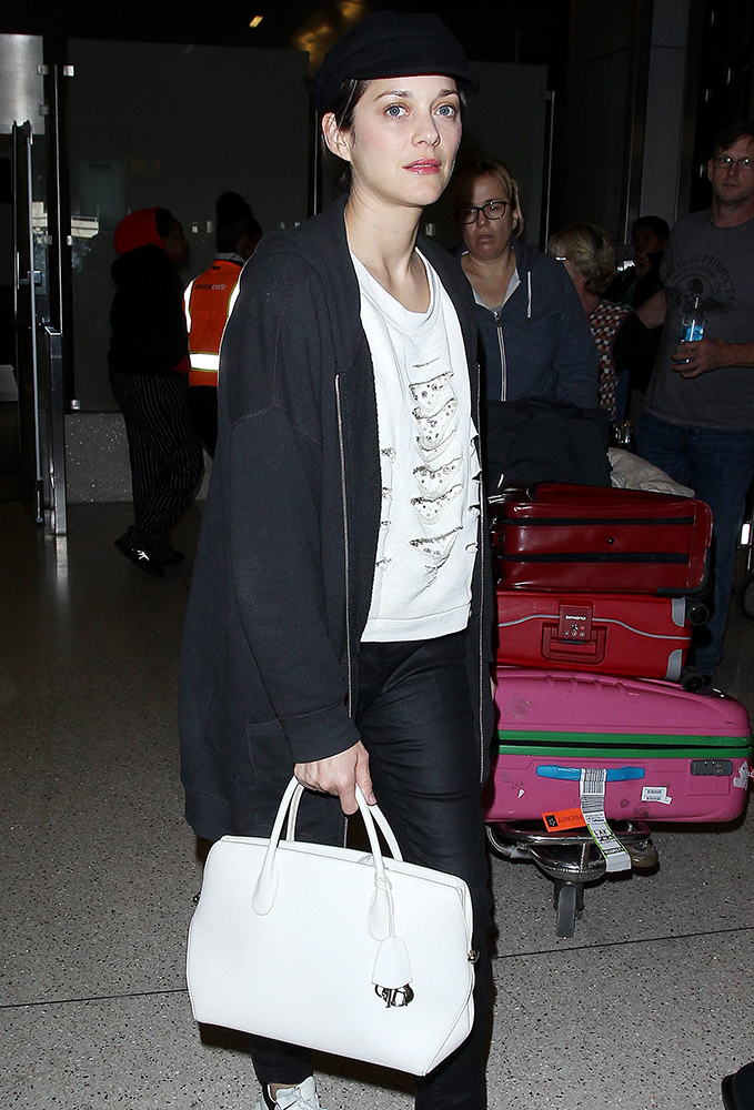 celebs shop and travel with bags from dior  valentino  u0026 givenchy