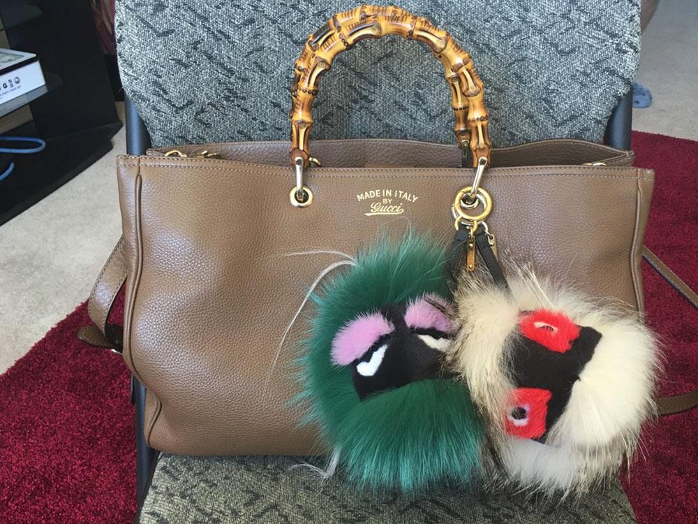 tPF Member: Fatcat2523 Shop Green Charm: $736 via Vesitaire Collective  Bag: Gucci Bamboo Shopper Bag: $2,100 via Net-a-Porter