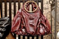 Jane August 57th Street in Maroon Python ($3,080)
