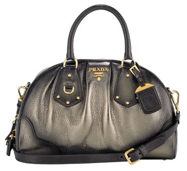 "Prada Antik Metallic Dome Bag /></noscript></p> 			</div> 						 	  	 		 	 			 		<!-- // POST-INNER --> 		</div> 		 		<footer class=""post-footer clr""> 			 			 			 			<div class=""post-share""> 				<a href=""https://www.facebook.com/sharer/sharer.php?u=http%3A%2F%2Fwww.purseblog.com%2Fprada%2Fprada-antik-metallic-dome-bag-fab-or-drab%2F"" class=""social-icon social-fb"" target=""_blank""><i class=""fa fa-facebook""></i> share it</a> 				<a href=""https://twitter.com/share?url=http%3A%2F%2Fwww.purseblog.com%2Fprada%2Fprada-antik-metallic-dome-bag-fab-or-drab%2F&via=purseblog&text=Prada Antik Metallic Dome Bag: Fab or Drab?"" class=""social-icon social-tw"" target=""_blank""><i class=""fa fa-twitter""></i> tweet it</a> 				<a href=""https://www.pinterest.com/pin/create/button/?url=http%3A%2F%2Fwww.purseblog.com%2Fprada%2Fprada-antik-metallic-dome-bag-fab-or-drab%2F&media=&description=Prada Antik Metallic Dome Bag: Fab or Drab?"" class=""social-icon social-pin"" target=""_blank""><i class=""fa fa-pinterest-p""></i> pin it</a> 			</div> 			 			<input name=""permalink"" type=""hidden"" value=""http%3A%2F%2Fwww.purseblog.com%2Fprada%2Fprada-antik-metallic-dome-bag-fab-or-drab%2F"" /> 			<input name=""page_title"" type=""hidden"" value=""Prada Antik Metallic Dome Bag: Fab or Drab?"" /> 			 		</footer> 		 	 					<div class=""related""> <div class=""wp_rp_wrap  wp_rp_plain"" id=""wp_rp_first""><div class=""wp_rp_content""><h3 class=""related_post_title"">You May Also Like...</h3><ul class=""related_post wp_rp""><li data-position=""0"" data-poid=""in-132580"" data-post-type=""none"" ><a href=""http://www.purseblog.com/prada/spring-2016-runway-bags-2/"" class=""wp_rp_thumbnail""><img src=""http://www.purseblog.com/images/2015/09/Prada-Spring-2016-Handbags-11-294x196.jpg"" alt=""Prada Maintains a Strong Trajectory with Its Spring 2016 Runway Bags"" width=""294"" height=""196"" /></a><a href=""http://www.purseblog.com/prada/spring-2016-runway-bags-2/"" class=""wp_rp_title"">Prada Maintains a Strong Trajectory with Its Spring 2016 Runway Bags</a></li><li data-position=""1"" data-poid=""in-3149"" data-post-type=""none"" ><a href=""http://www.purseblog.com/prada/prada-ombre-patent-leather-tote-fab-or-drab/"" class=""wp_rp_thumbnail""><img src=""http://www.purseblog.com/images/2016/10/related-default.gif"" alt=""Prada Ombre Patent Leather Tote: Fab or Drab? "" width=""294"" height=""196"" /></a><a href=""http://www.purseblog.com/prada/prada-ombre-patent-leather-tote-fab-or-drab/"" class=""wp_rp_title"">Prada Ombre Patent Leather Tote: Fab or Drab? </a></li><li data-position=""2"" data-poid=""in-2537"" data-post-type=""none"" ><a href=""http://www.purseblog.com/messenger-bags/prada-nappa-gaufre-messenger/"" class=""wp_rp_thumbnail""><img src=""http://www.purseblog.com/images/2016/10/related-default.gif"" alt=""Prada Nappa Gaufre Messenger"" width=""294"" height=""196"" /></a><a href=""http://www.purseblog.com/messenger-bags/prada-nappa-gaufre-messenger/"" class=""wp_rp_title"">Prada Nappa Gaufre Messenger</a></li><li data-position=""3"" data-poid=""in-3881"" data-post-type=""none"" ><a href=""http://www.purseblog.com/totes/prada-crispy-nylon-tote/"" class=""wp_rp_thumbnail""><img src=""http://www.purseblog.com/images/prada-crispy-nylon-tote-294x196.jpg"" alt=""Prada Crispy Nylon Tote"" width=""294"" height=""196"" /></a><a href=""http://www.purseblog.com/totes/prada-crispy-nylon-tote/"" class=""wp_rp_title"">Prada Crispy Nylon Tote</a></li></ul></div></div> </div> 		 		 					<!-- LIST COMMENTS  --> 			<div id=""comments""> 				<h3 class=""heading"">Share Your Thoughts With Us</h3> 				 <div id=""disqus_thread"">     </div>  			</div>	 				 		 	<div id=""TPFresources""> 	<h3 class=""heading"">Join The <a href=""http://forum.purseblog.com/forums/prada.192/"">Prada Community</a> On PurseForum</h3> 	<ul> 		<li><a href=""http://forum.purseblog.com/threads/authenticate-this-prada.899598/"">Authenticate This Prada</a> - Get help with Prada authenticity-related questions</li> 		<li>Get local and travel shopping recommendations in the <a href=""http://forum.purseblog.com/forums/prada-shopping.306/"">Prada Shopping</a> sub-forum</li> 		<li>Discover daily reveals and post your own reveals in the <a href=""http://forum.purseblog.com/forums/prada.192/"">Prada forum</a></li> 		<li>Identify classic Prada bags and learn more about the brand in the <a href=""http://forum.purseblog.com/forums/prada-reference-library.270/"">Prada Reference Library</a></li> 	</ul> 	<p>No <a href=""http://forum.purseblog.com/"">PurseForum</a> account? No problem, <a href=""http://forum.purseblog.com/index.php?register"">it"