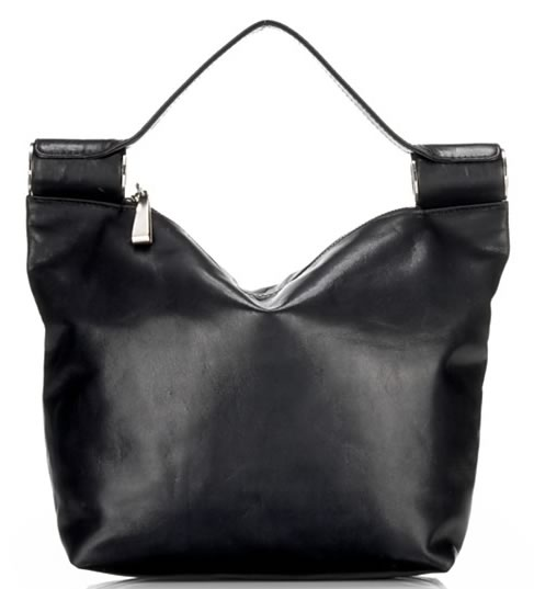 fb14122172 Yohji Yamamoto Leather Bag with Metal Rinds. You know what I like  I like  it when brands that we don t normally associate with handbags make a handbag  line.