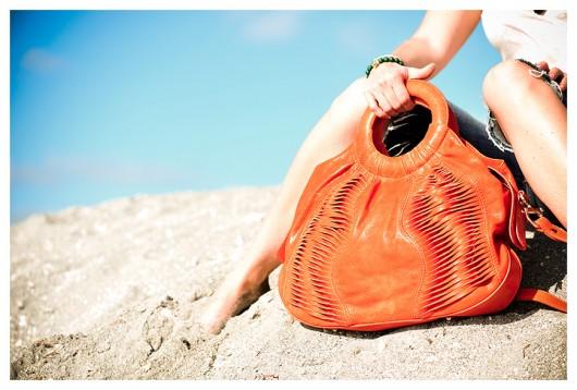 Gustto Torsa in Orange on the beach