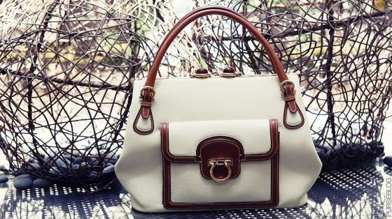 (1) Ferragamo Resort Leather Bag with brown trim and tortoise shell closure - $2,550