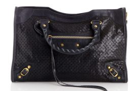 Balenciaga re-imagines the City Bag with black studs and gold hardware