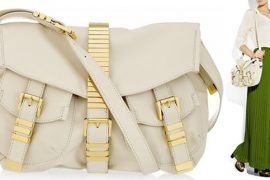 Pair a bold skirt with this Michael Kors Buckled Bag