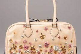 Fill in the blank: The Valentino Napa Straw-Flower Duffel is…