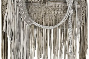 Fill in the blank: The Roberto Cavalli Doctor Fringed Bag is…