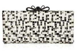 Clutch or crossword? Somehow, Christian Louboutin solves the puzzle