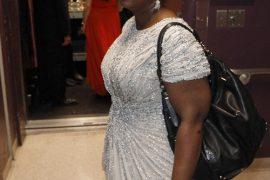 Octavia Spencer carries an Oscar and a Coach Pinnacle Allie