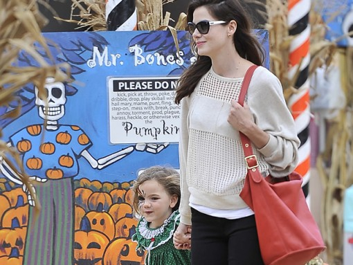 Michelle Monaghan carries Coach and also visits Mr. Bones Pumpkin Patch