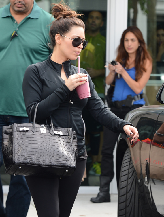 Just Can't Get Enough: Kim Kardashian and her crocodile ...