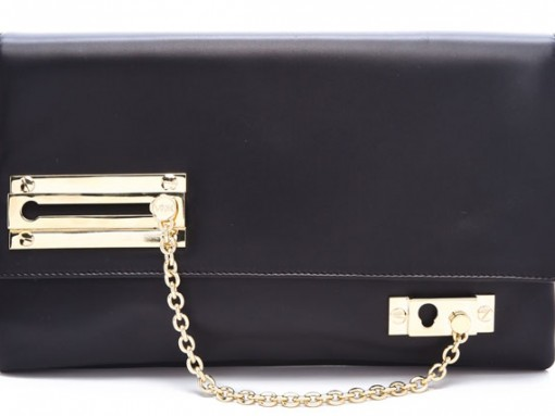 The Viktor & Rolf Lock and Chain clutch will help keep the Robbers away