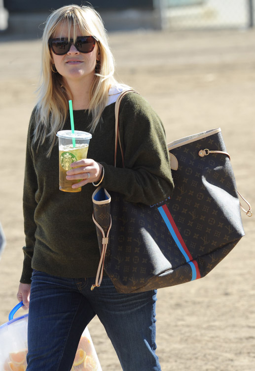 reese witherspoon carries orange wedges and louis vuitton at her son u0026 39 s soccer game