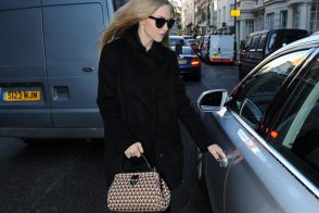 Amanda Seyfried livens up a dark ensemble with Prada