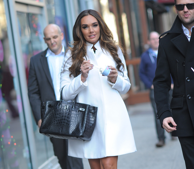 Tamara Ecclestone and unidentified male companion get ice cream, New York City