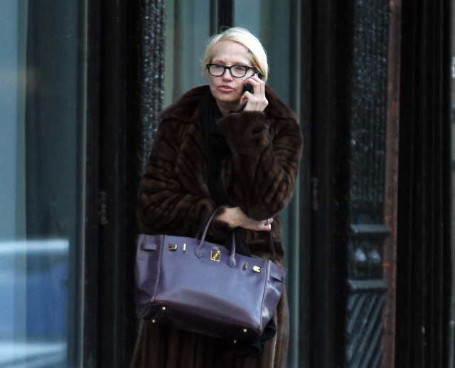 Ellen Barkin takes a phone call while shopping around Manhattan, NYC