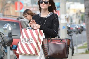 Emmy Rossum is casual with a Christian Louboutin tote