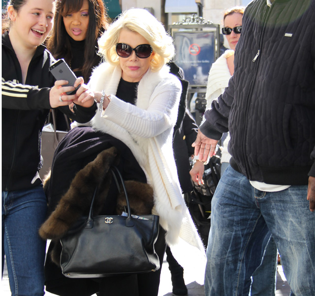 """25fa77e80a9f Joan Rivers carries a Chanel Cerf Tote to hang out on the set of """"Extra"""""""