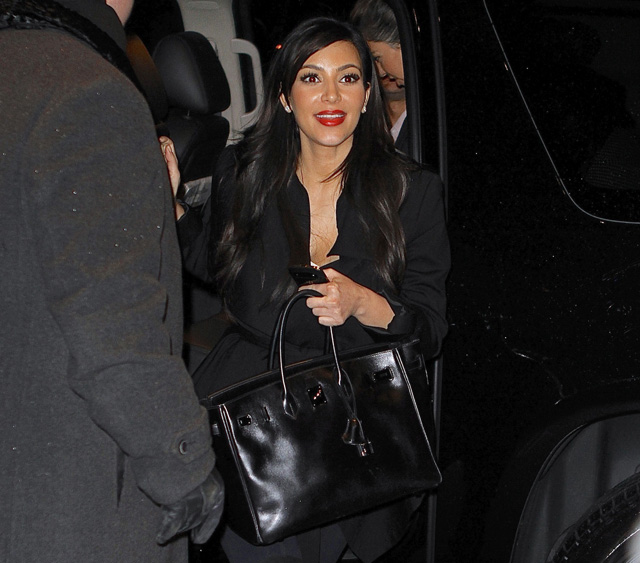 Kim and Kourtney arrive back from dinner in NYC