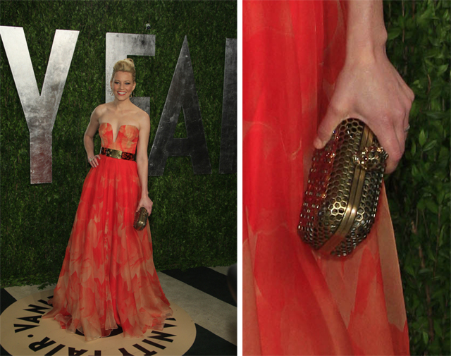 Elizabeth Banks carries Alexander McQueen to the Vanity Fair party.
