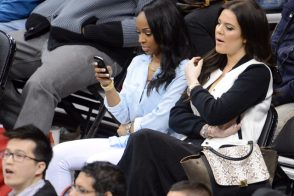 Khloe Kardashian keeps her Celine Trapeze by her side at a Clippers game