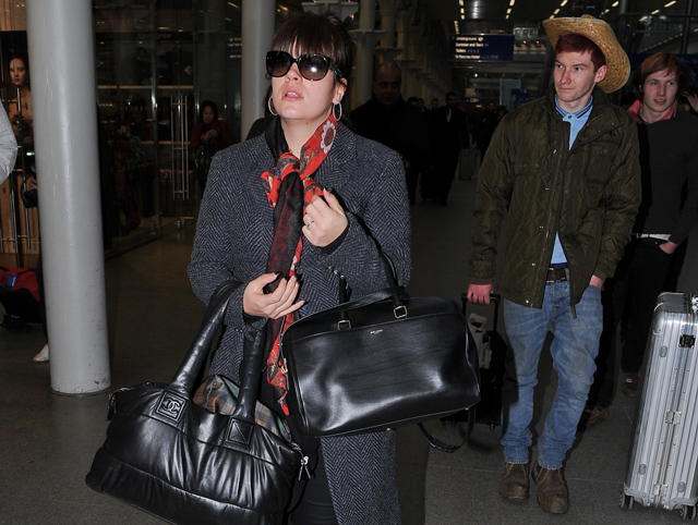 Lily Allen carres a Chanel Coco Cocoon Bag and a Saint Laurent Classic Duffel Bag (1)