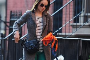 Olivia Wilde walks her dog with a Proenza Schouler pouch at her side
