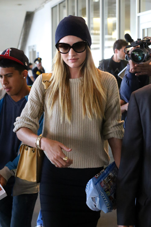 Candice Swanepoel carries a beige Chloe Sally Bag at LAX (4)