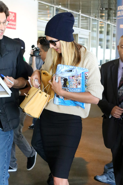 Candice Swanepoel carries a beige Chloe Sally Bag at LAX (3)
