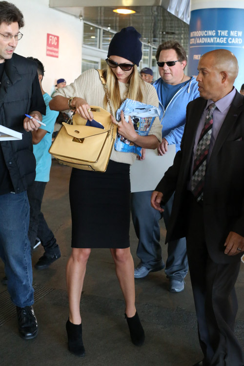 Candice Swanepoel carries a beige Chloe Sally Bag at LAX (2)