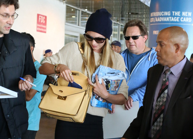 Candice Swanepoel carries a beige Chloe Sally Bag at LAX (5)