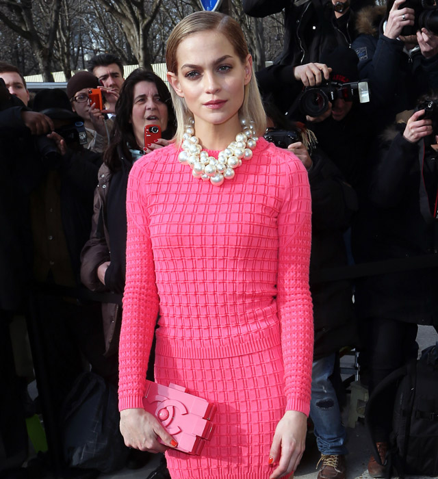 Leigh Lezark carrying a pink Chanel Lego Clutch at the Chanel Fall 2013 show