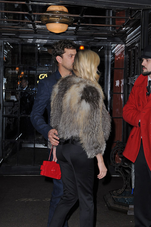 Diane Kruger carries a red Chanel Lego Clutch while leaving her NYC hotel (2)