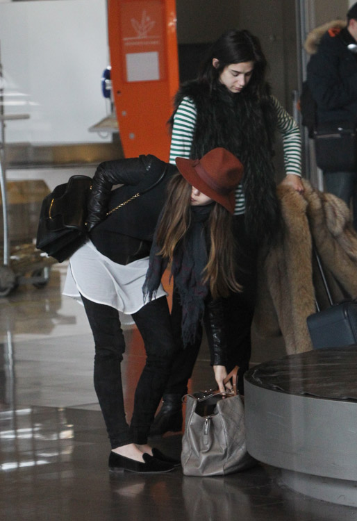 Elizabeth Olsen Lands In Paris With A Chanel Carry On And
