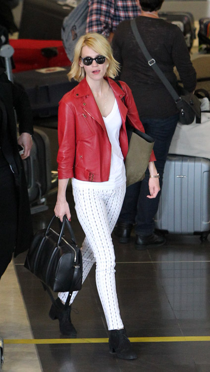 January Jones carries a black Givenchy Lucrezia bag at Roissy Airport in Paris (4)