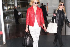 January Jones carries a black Givenchy Lucrezia bag at Roissy Airport in Paris (5)