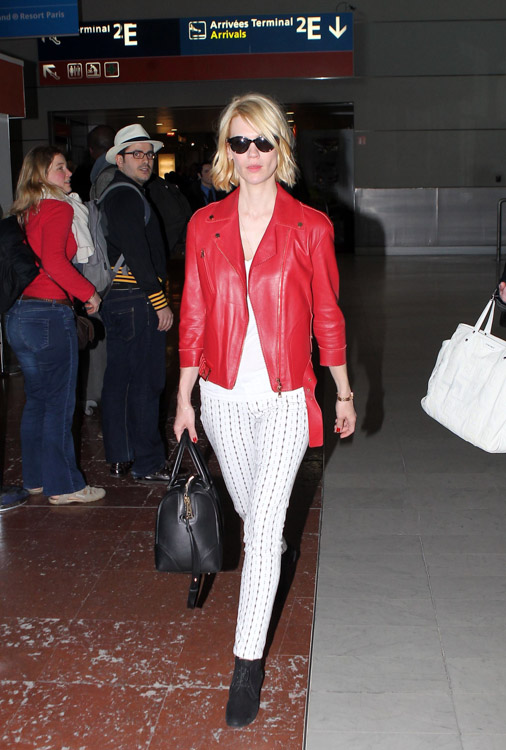 January Jones carries a black Givenchy Lucrezia bag at Roissy Airport in Paris (1)