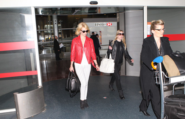 January Jones carries a black Givenchy Lucrezia bag at Roissy Airport in Paris (2)