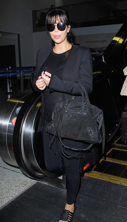Kim Kardashian carries a black suede Balenciaga City Bag at the airport in Los Angeles. (2)