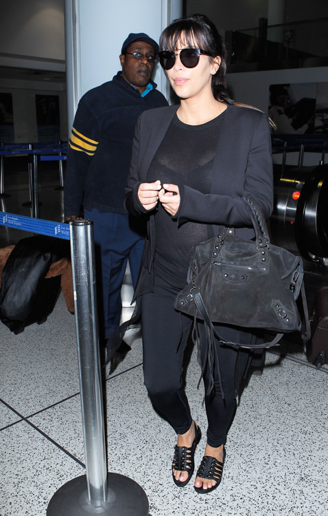 Kim Kardashian carries a black suede Balenciaga City Bag at the airport in Los Angeles. (1)