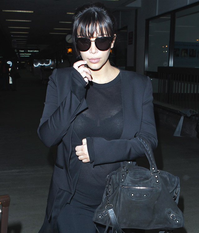 Kim Kardashian carries a black suede Balenciaga City Bag at the airport in Los Angeles. (4)