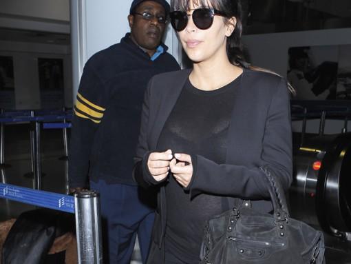 Kim Kardashian carries a black suede Balenciaga City Bag at the airport in Los Angeles. (5)