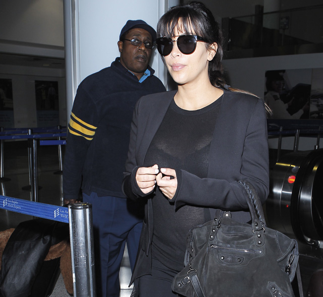 Kim Kardashian carries a black suede Balenciaga City Bag at the airport in Los Angeles. (5)