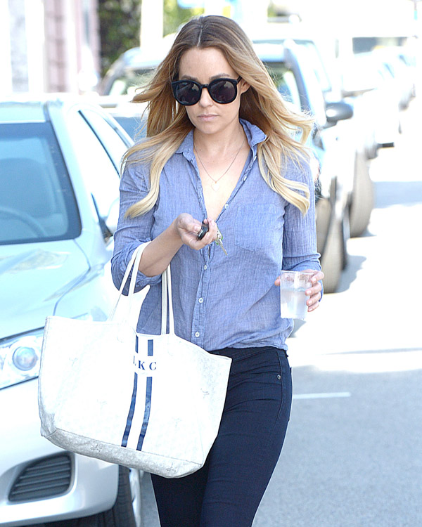 Lauren Conrad carries a white Goyard St. Louis Tote personalized with her initials (2)
