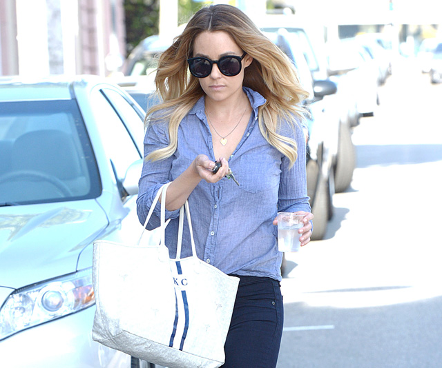 Lauren Conrad carries a white Goyard St. Louis Tote personalized with her initials (5)