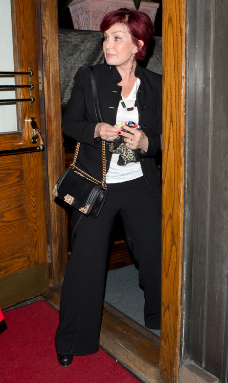 Sharon Osbourne carries a black Chanel Boy Bag with gold accents (1)