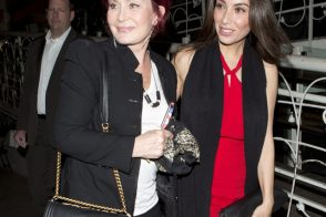 Sharon Osbourne carries a black Chanel Boy Bag with gold accents (5)