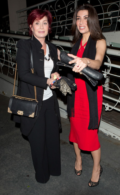Sharon Osbourne carries a black Chanel Boy Bag with gold accents (4)