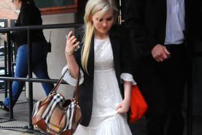 Abigail Breslin, (almost) all grown up, carries a Burberry bag in New York