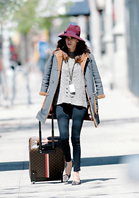 Alexa Chung wheels a Louis Vuitton Mon Monogram Pegase Suitcase around Manhattan (1)